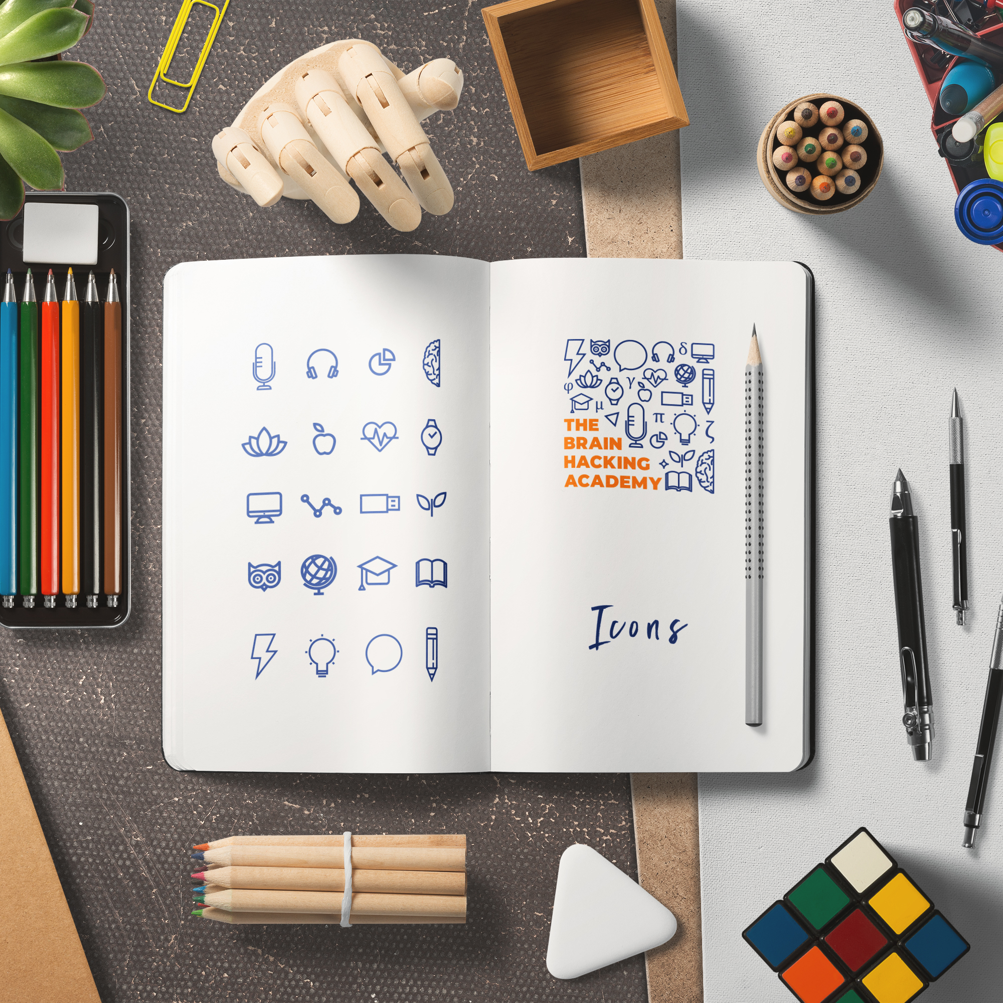 The Brain Hacking Academy logo and icons on a notepad and several stationery items