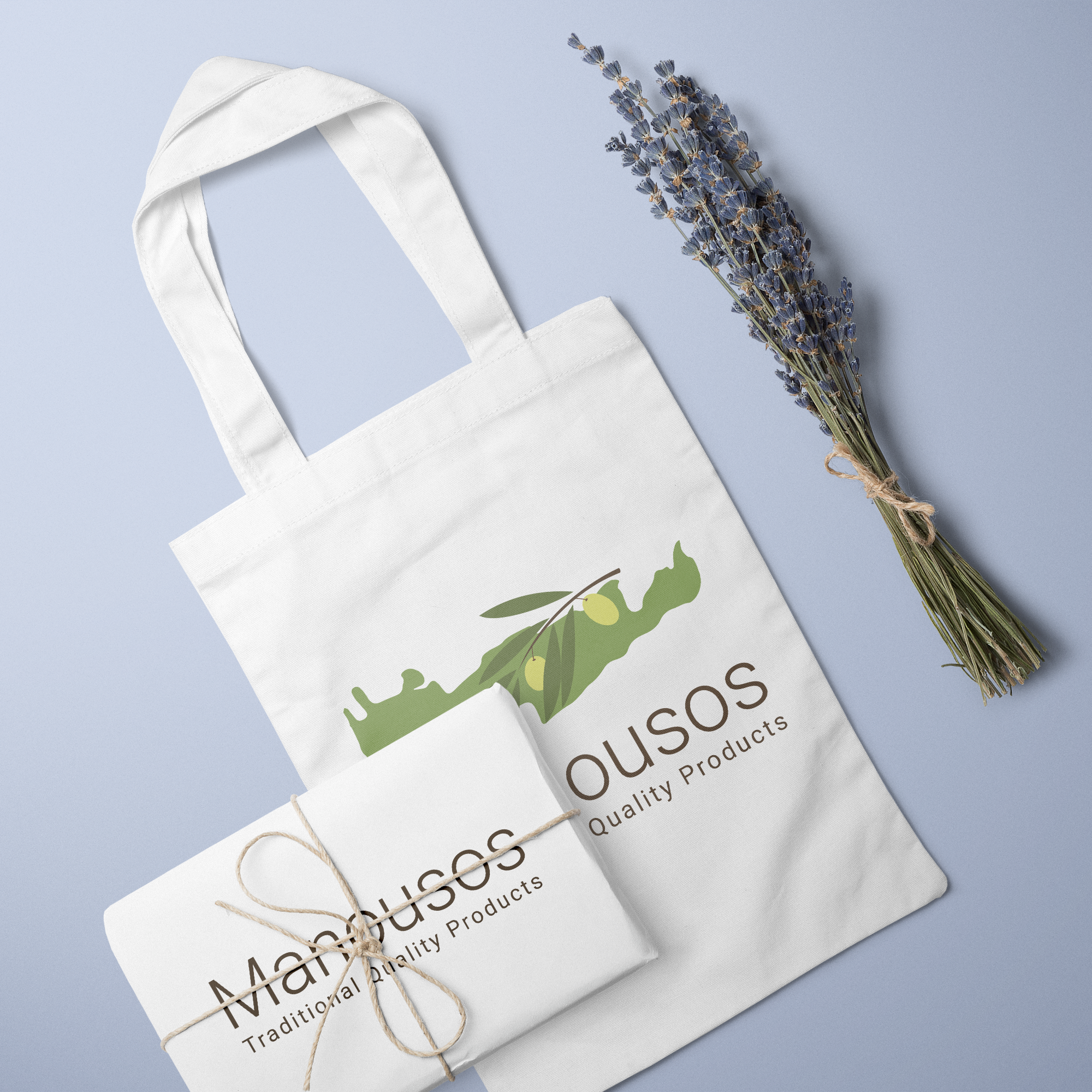 Manousos logo on a tote bag and a box