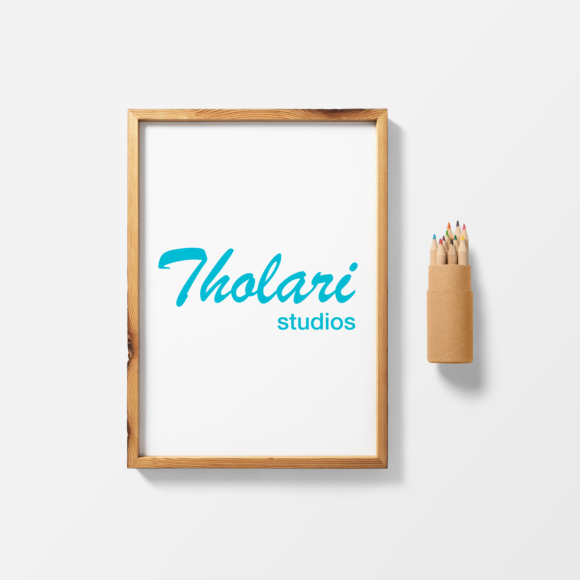 Tholari Studios logo surrounded by a wooden frame